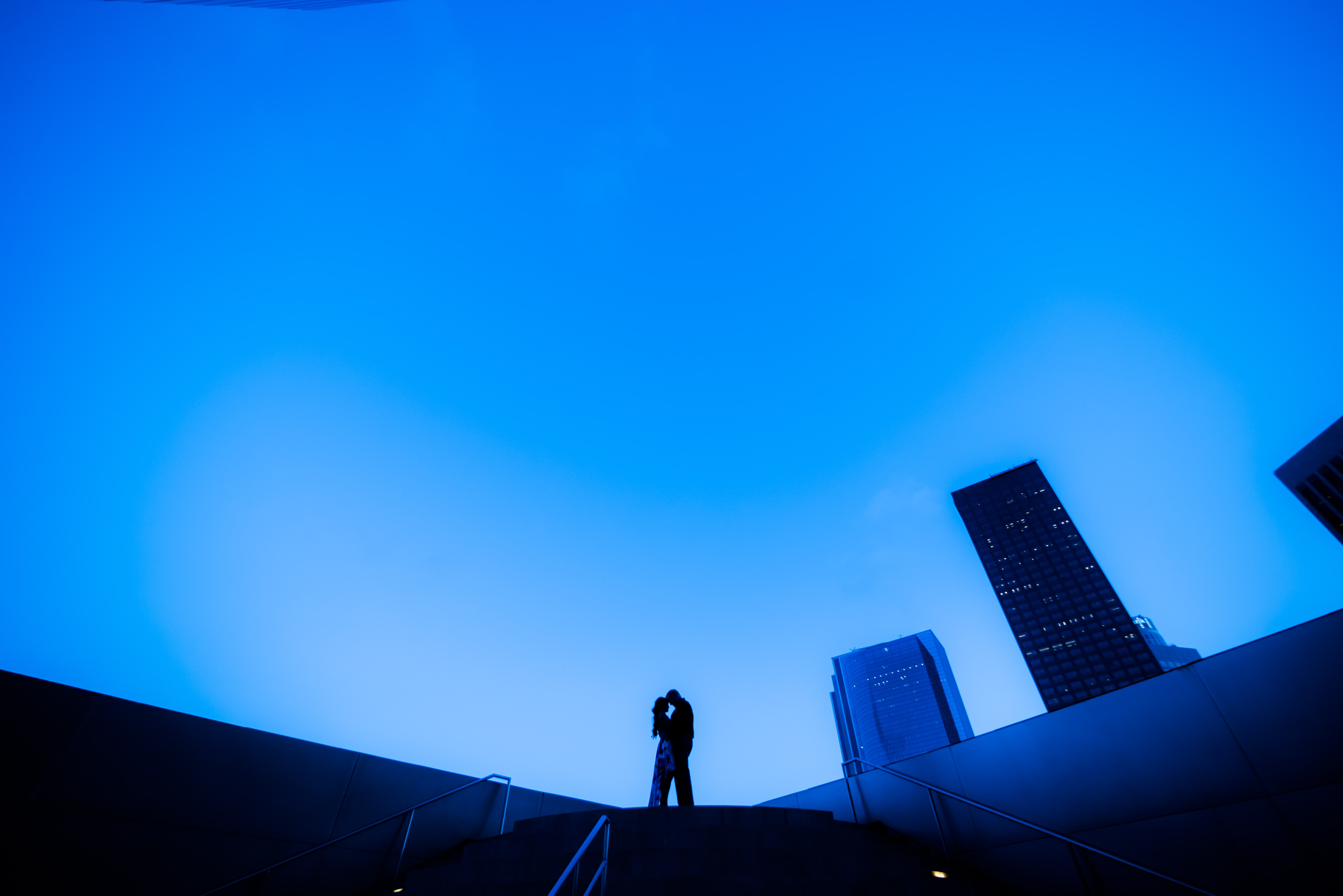 silhouette of two person standing