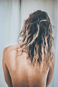 woman showing brown hair
