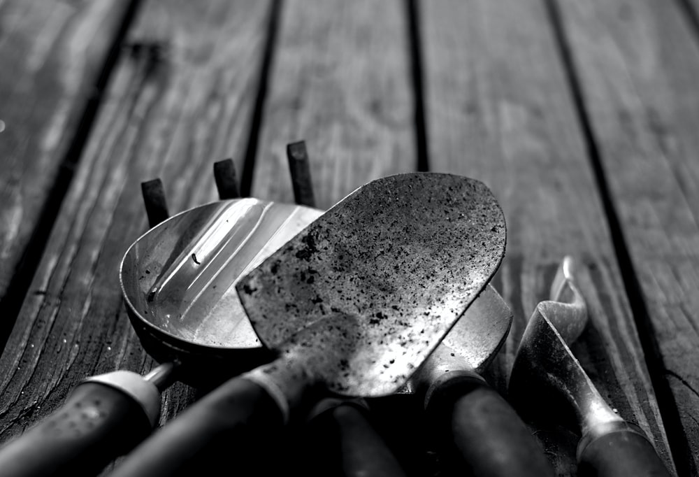 greyscale photo of gardening tools