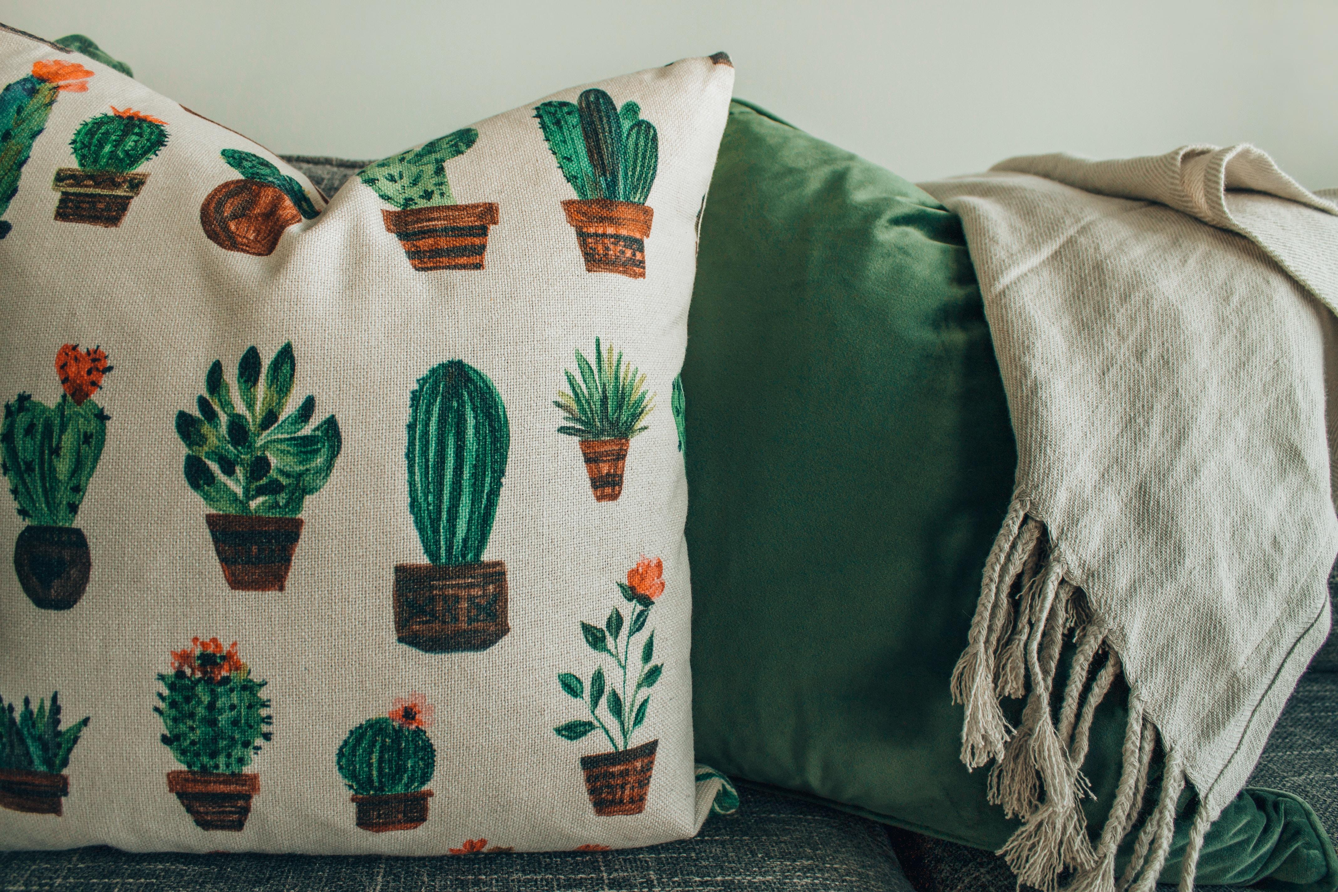 cactus-printed throw pillows on chair