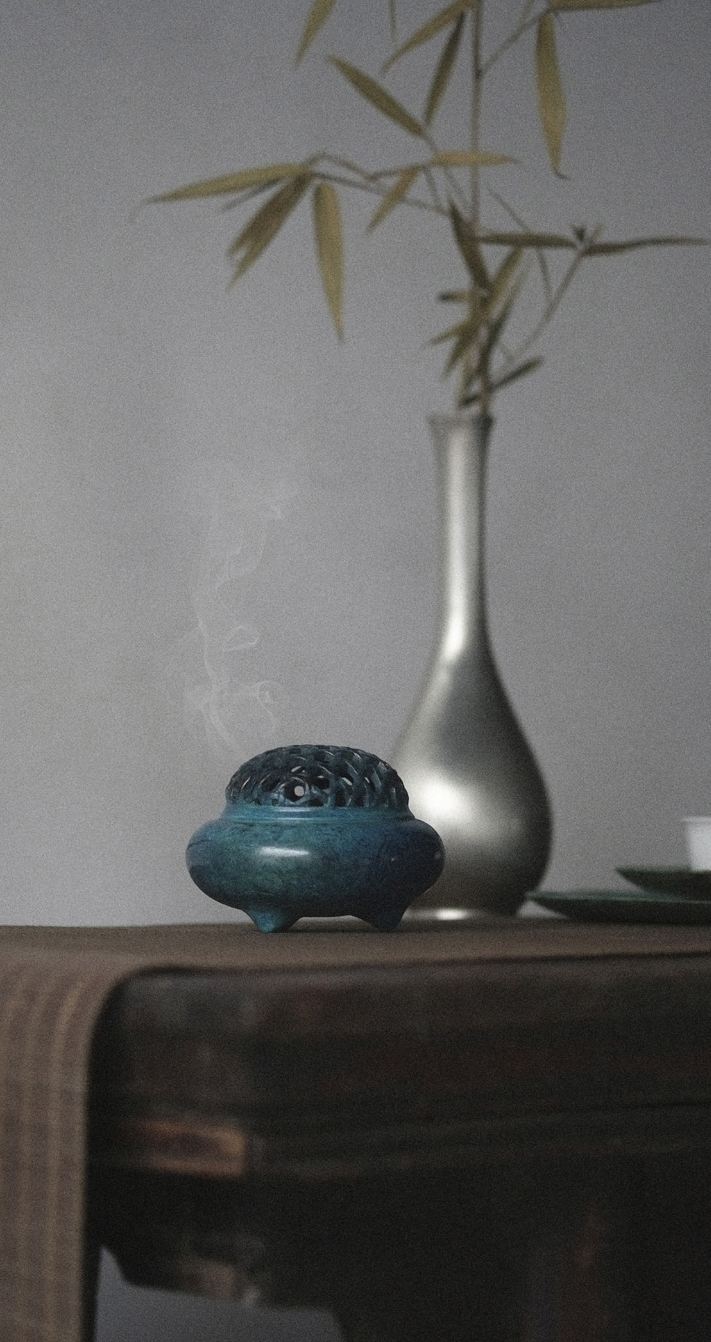 teal container on brown wooden desk