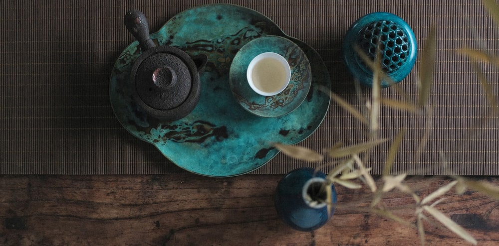 flat lay photography of teapot on tray