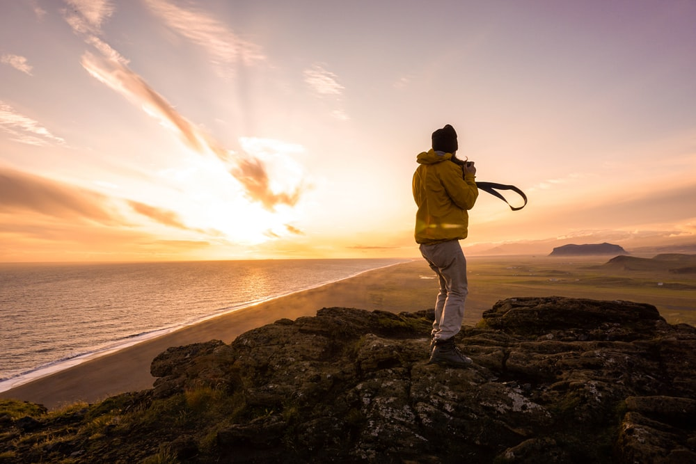 man taking sunset photo