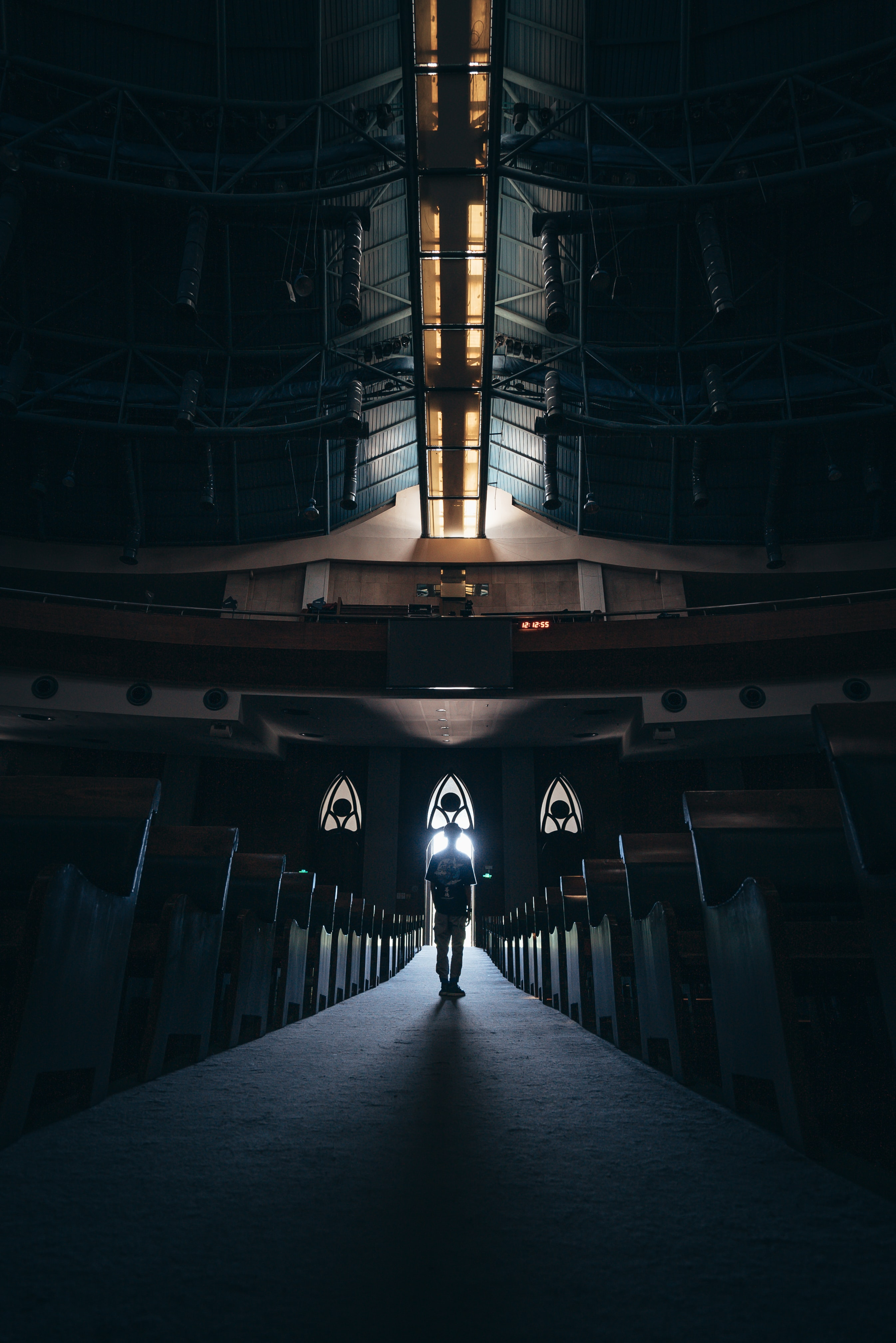 man standing in the middle of church