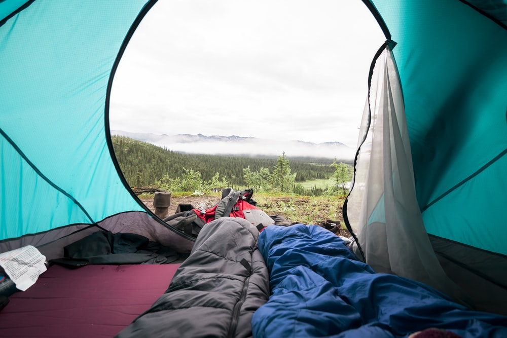 blue and gray sleeping mat inside tent