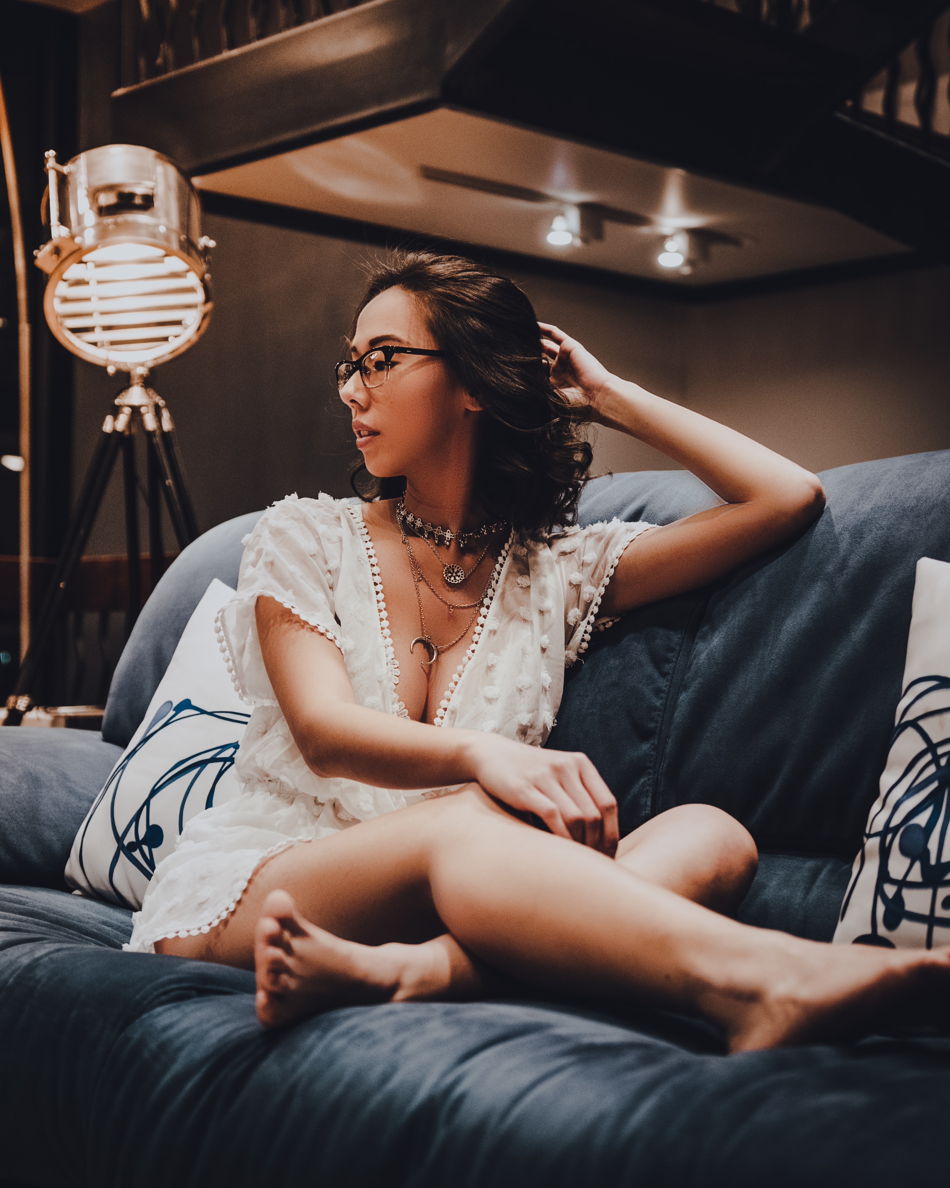 woman sitting on blue suede couch