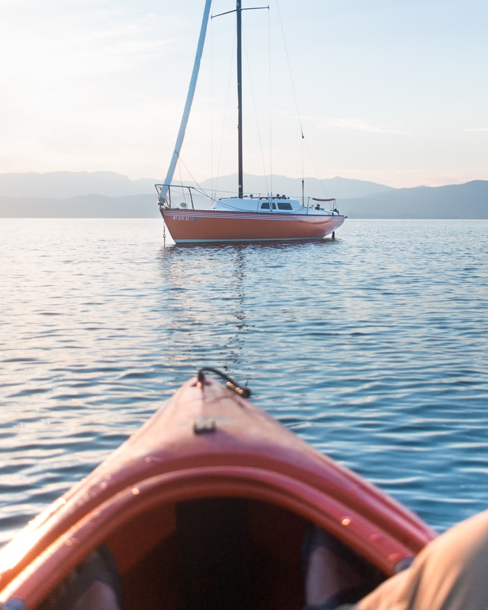 a view of a boat from a kayak on Flathead Lake, Montana
