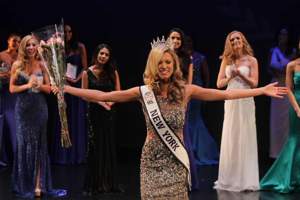 Miss New York spreading her arms while smiling