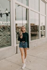 woman walking beside building