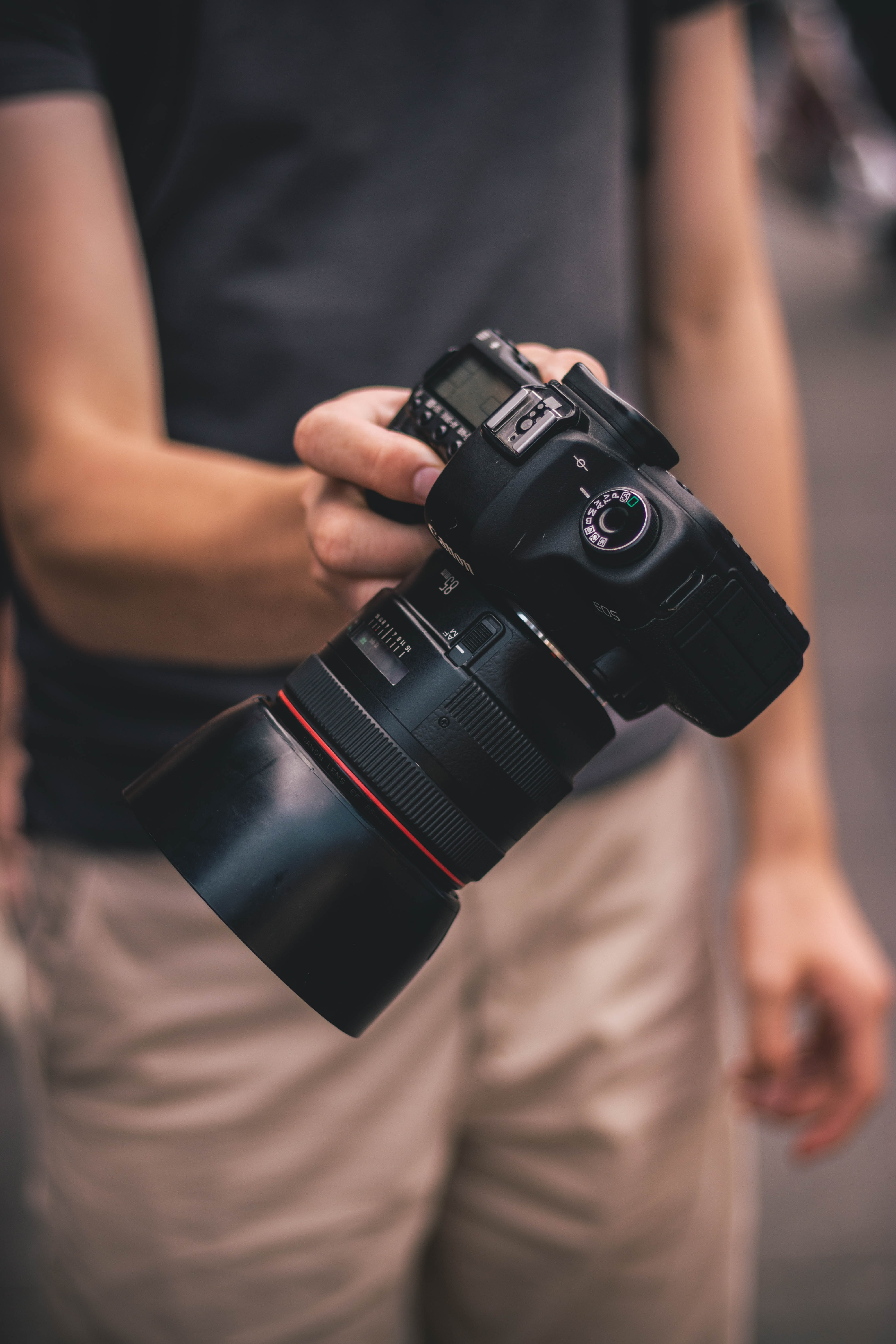 person holding DLSR camera
