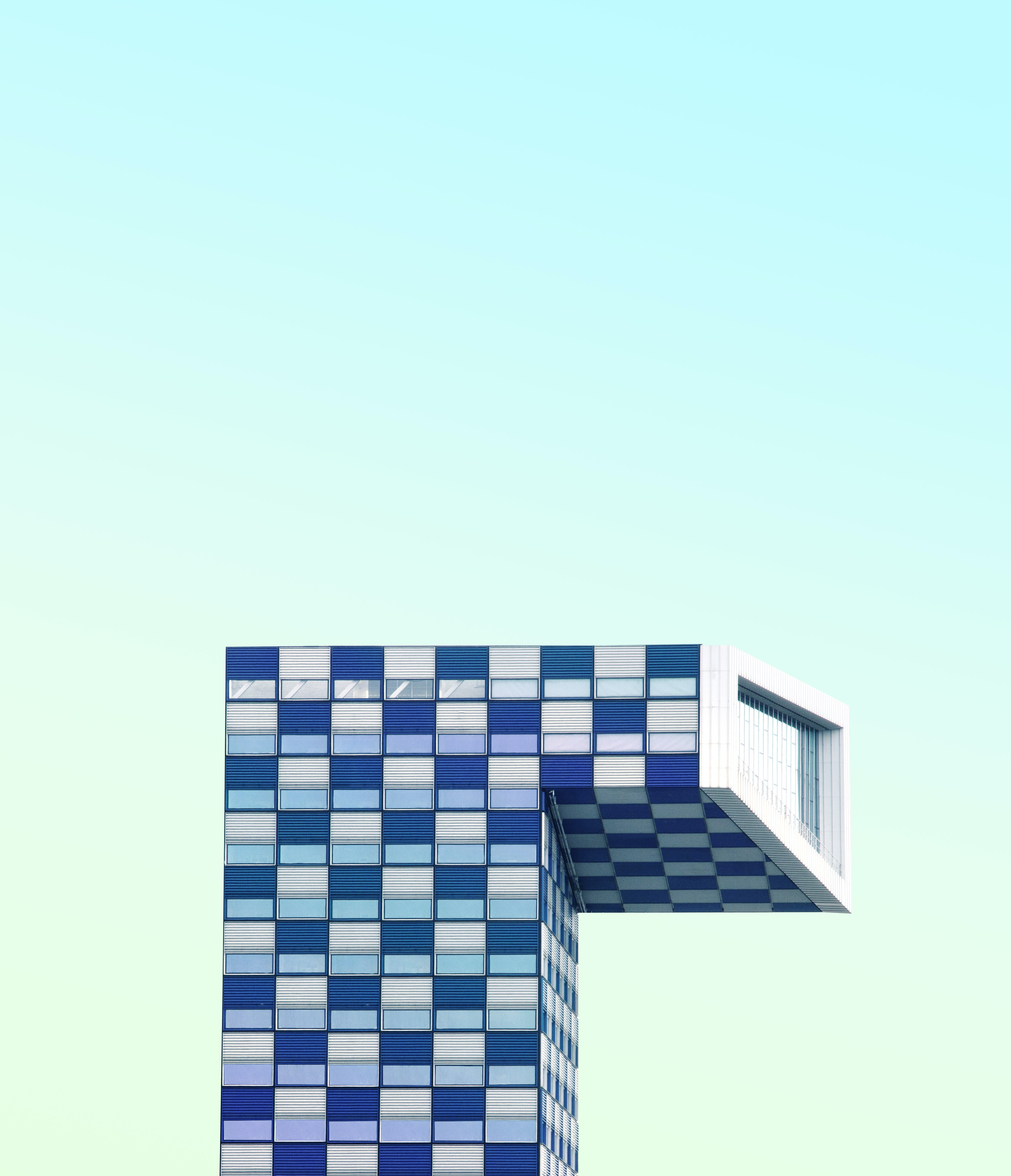 architecutural photography of white and blue painted building