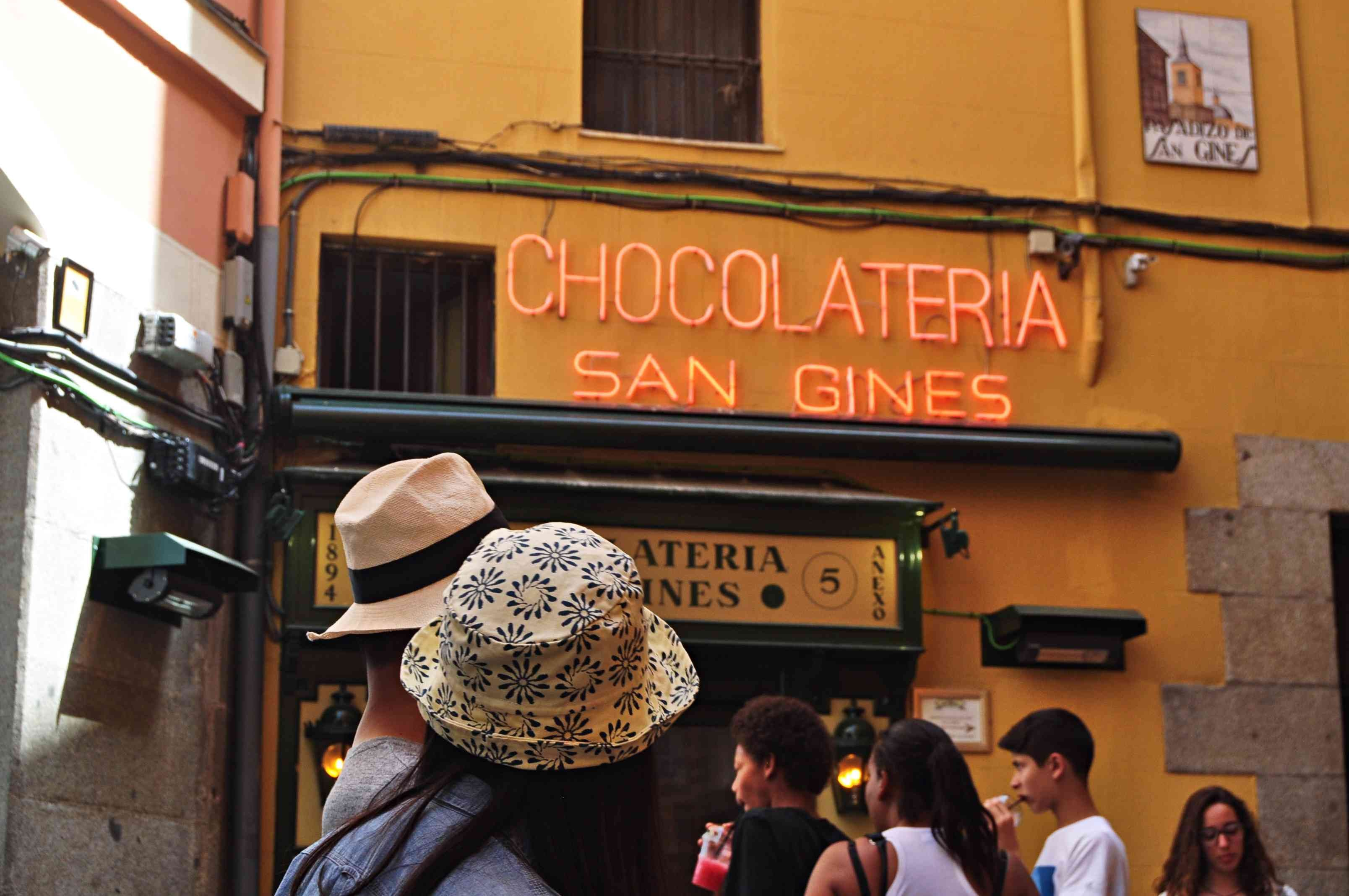 people standing at Chocolateria San Gines building