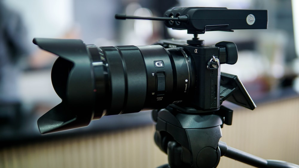 selective focus photography of DSLR camera placed on tripod