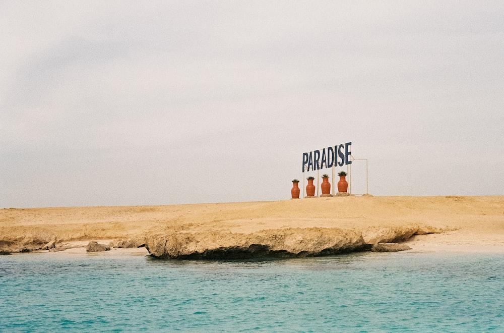 Paradise signage on seashore