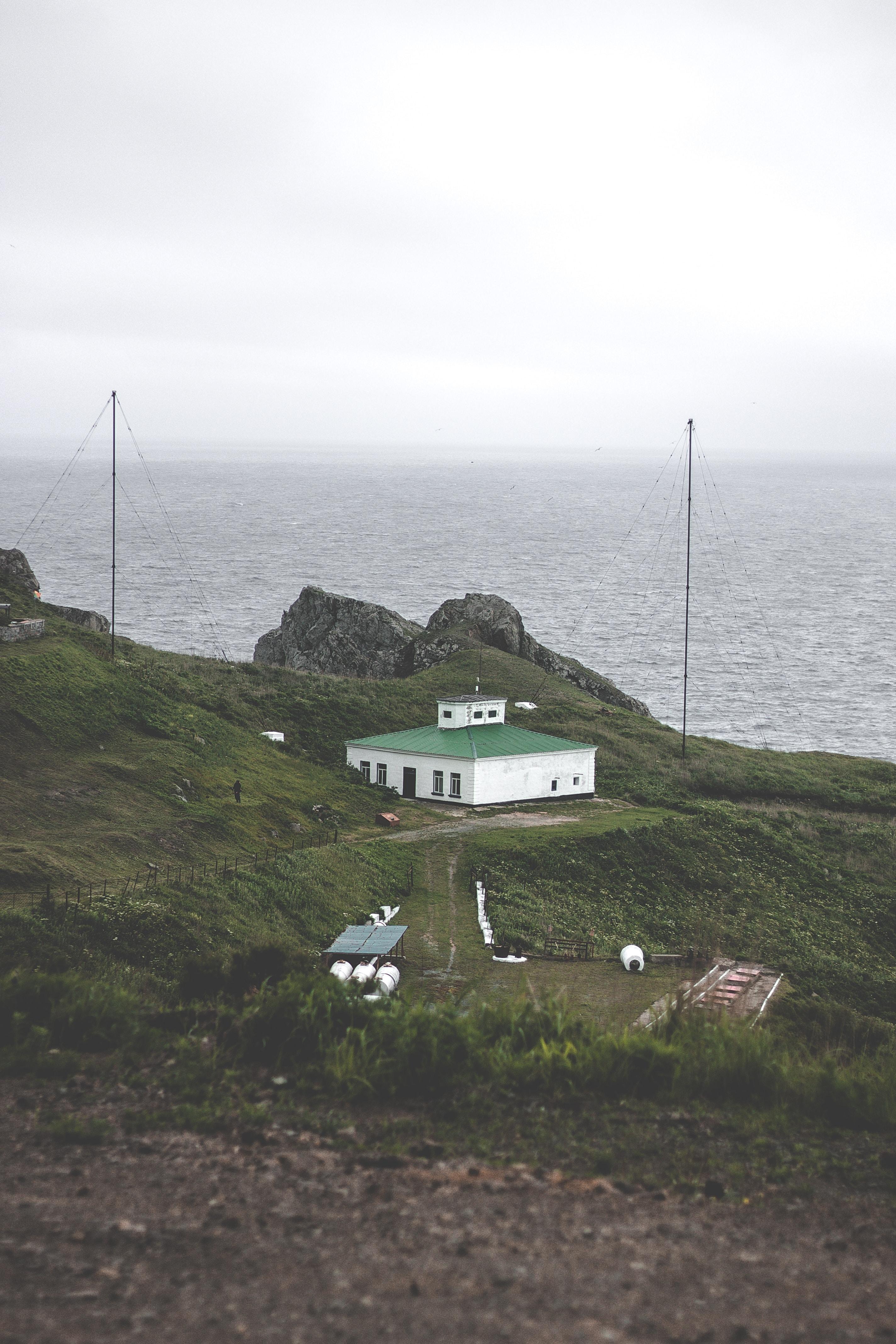 concrete house on mountain near sea