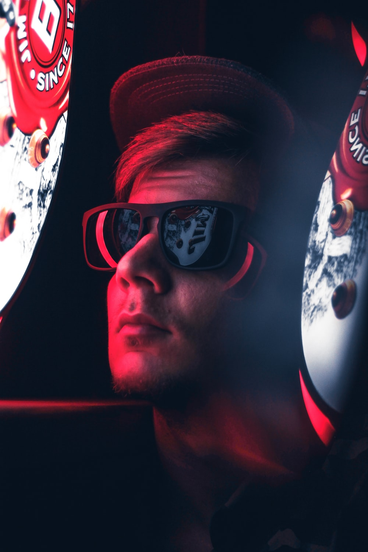 photo of man in black Wayfarer sunglasses
