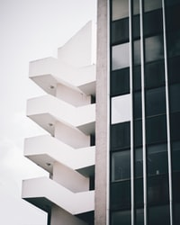 low angle photography of white high rise building