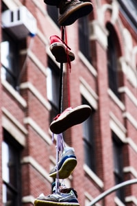 assorted shoes tied up hanging