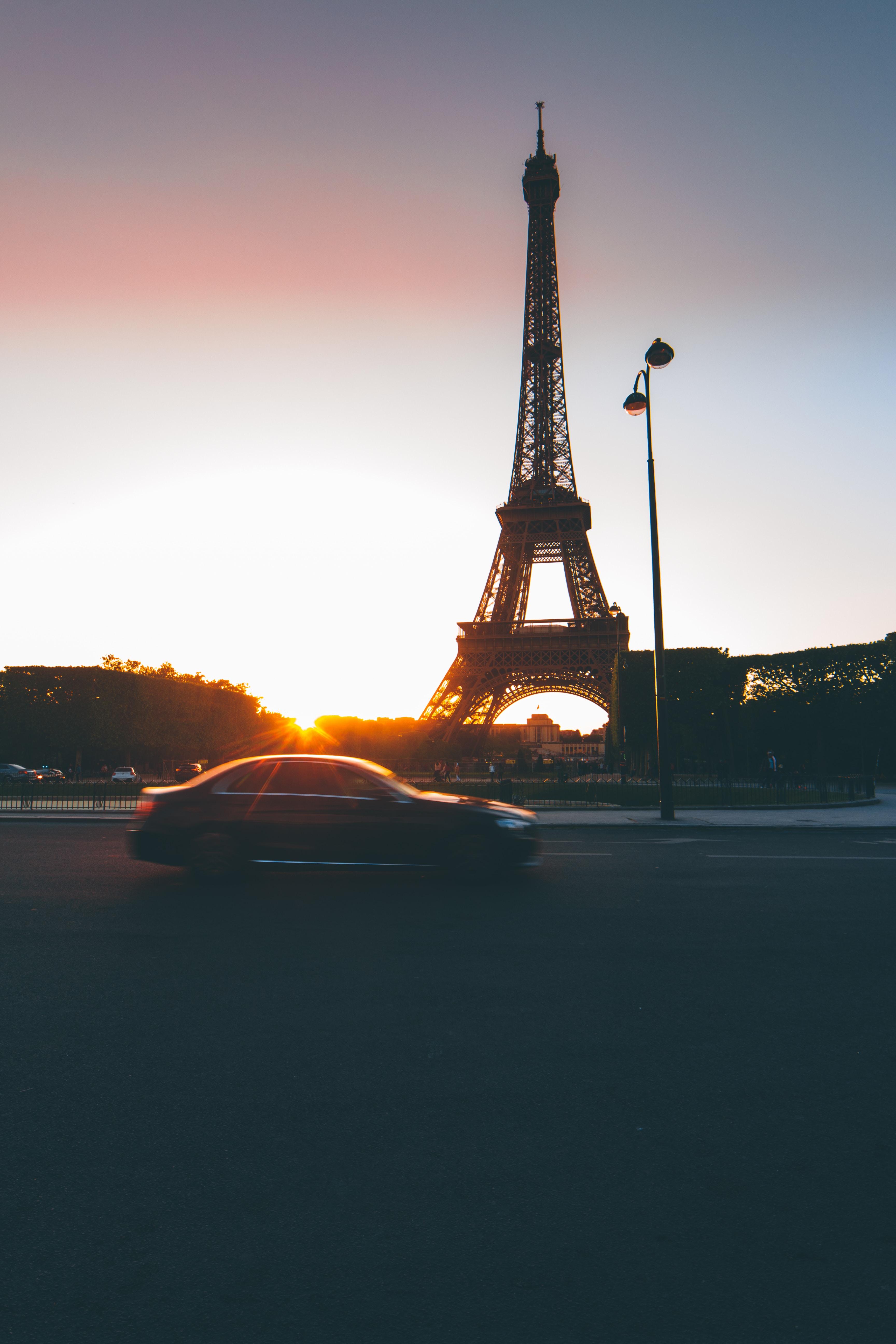 car near Eiffel Tower at golden hour