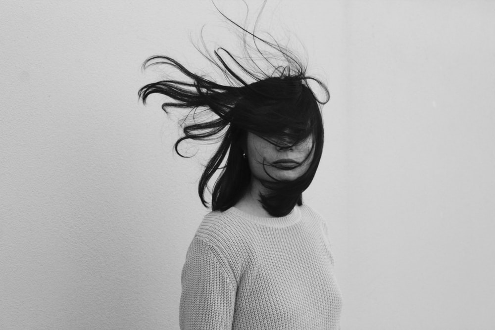 woman's hair covering her face