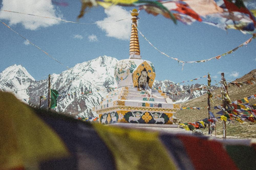 yellow and white tower near mountain