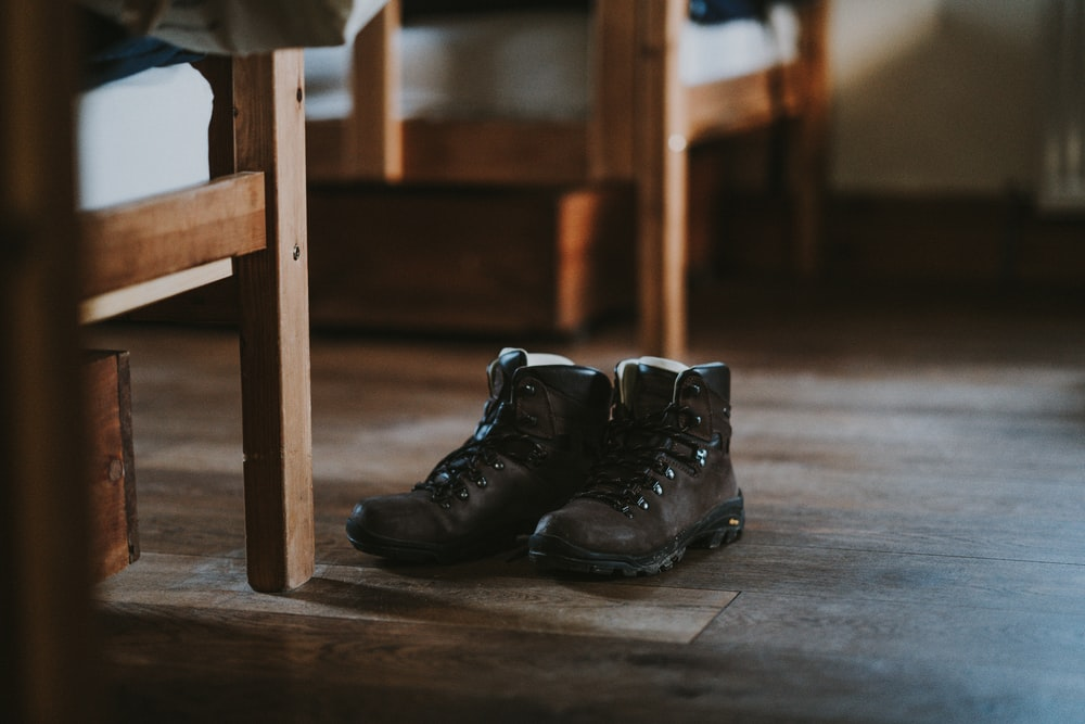 brown boots on floor beside chair