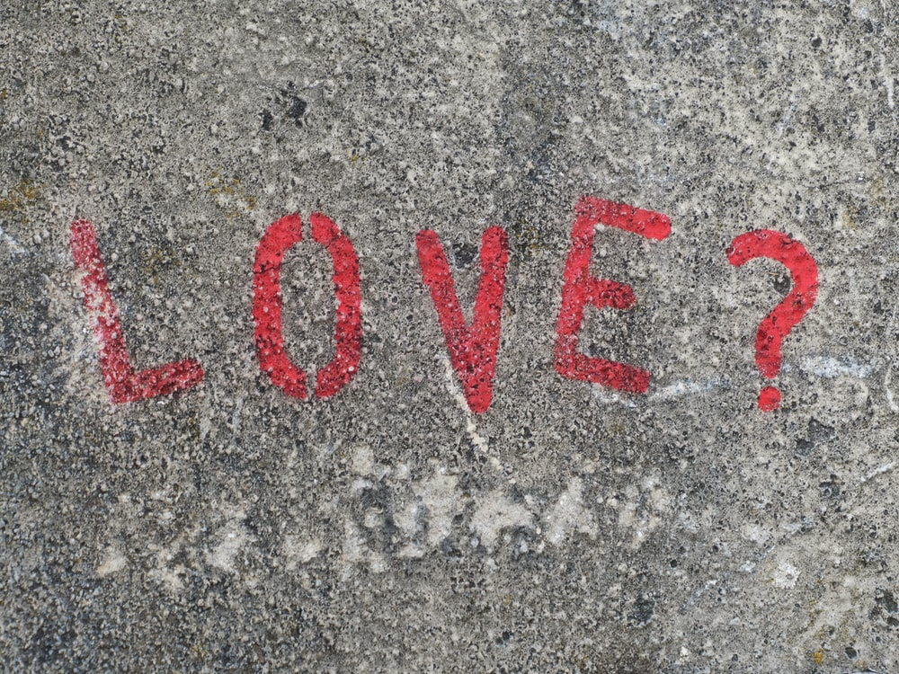love text showing on gray concrete surface