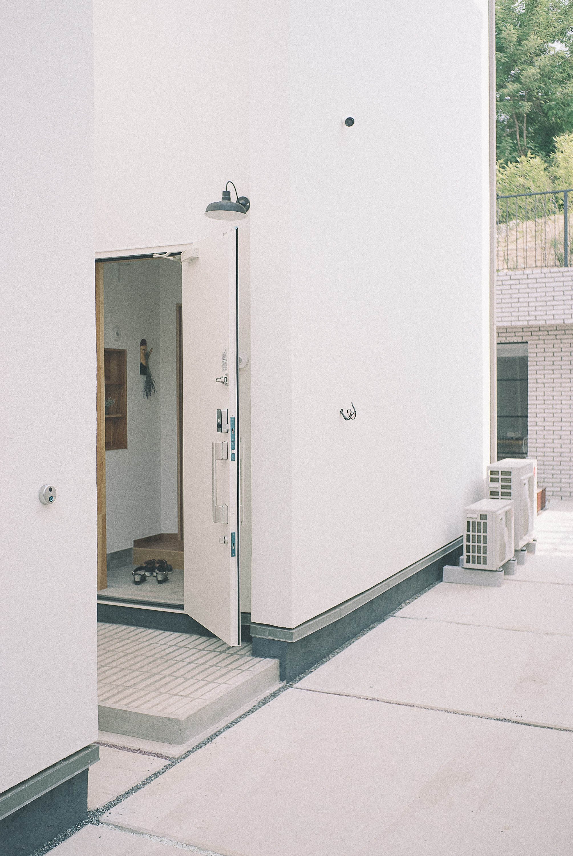 white concrete building with open door at daytime