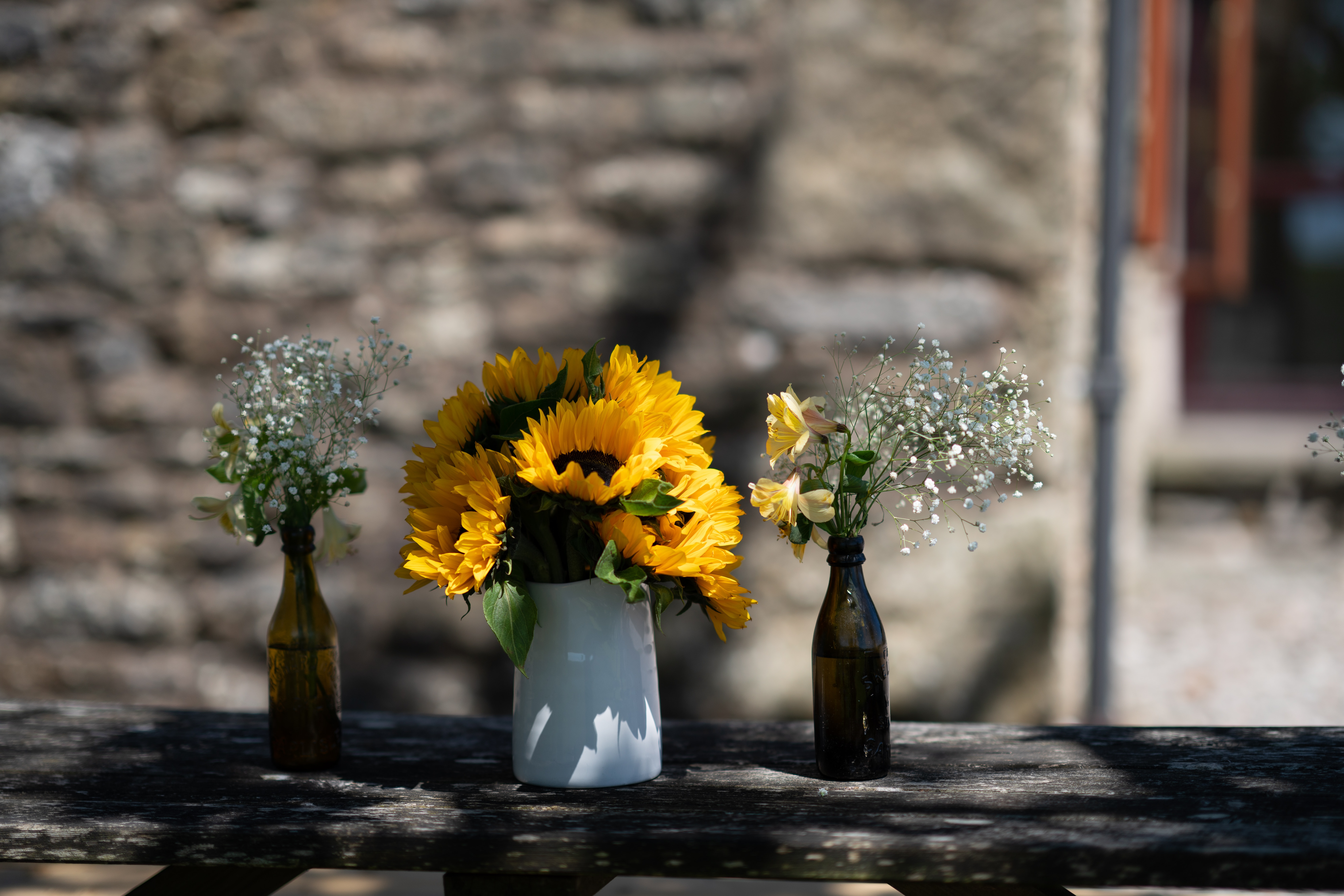 selective focus photography of yellow sunflower in vase