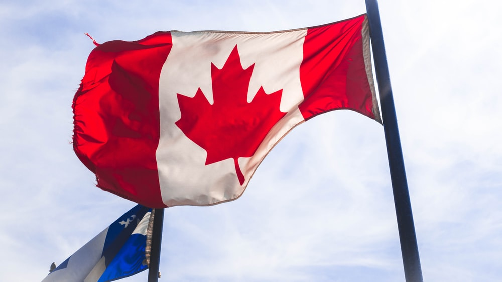 Canada flag waving during daytime