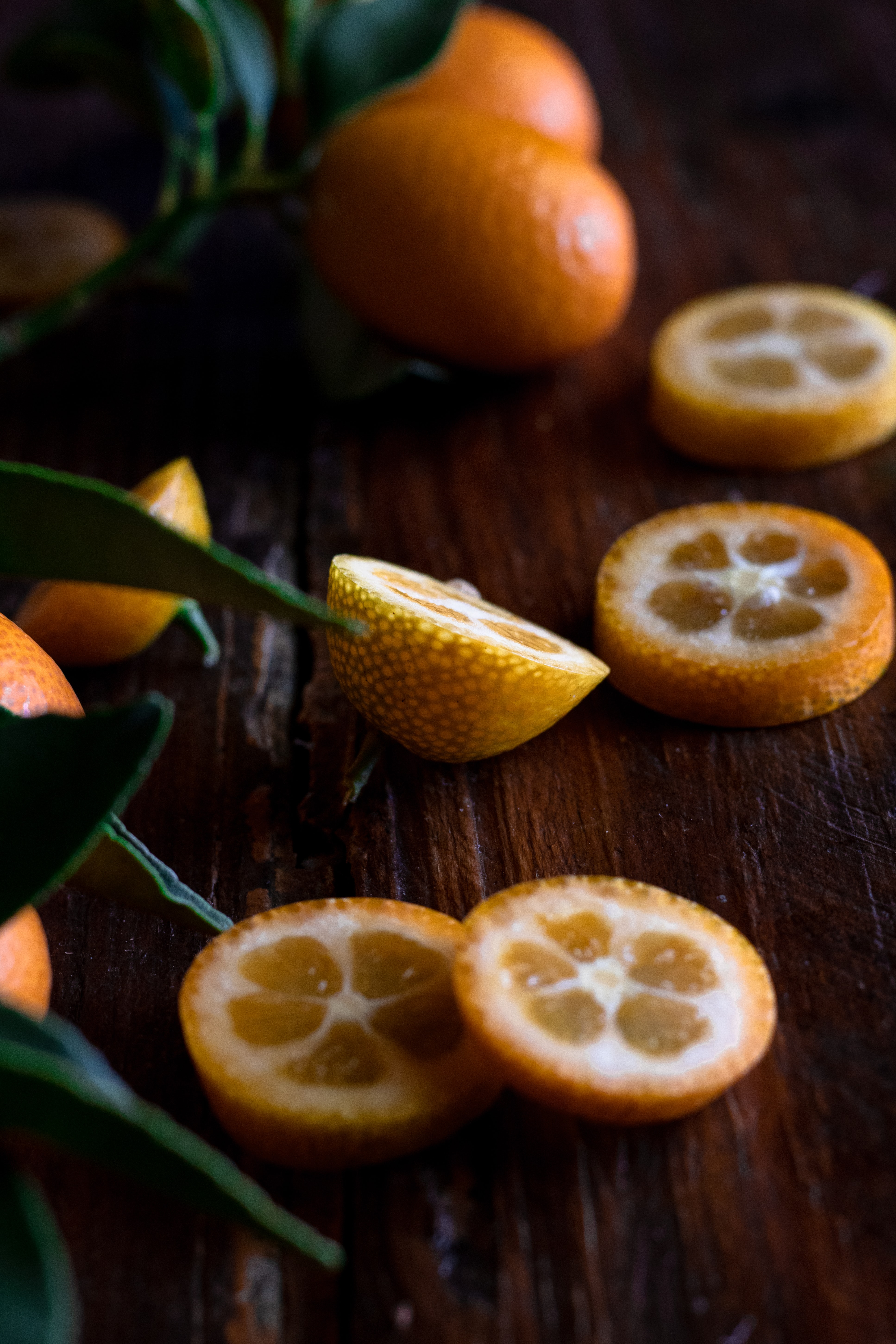 selective focus photography of sliced orange fruits