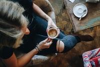 woman sitting on chair having her coffee