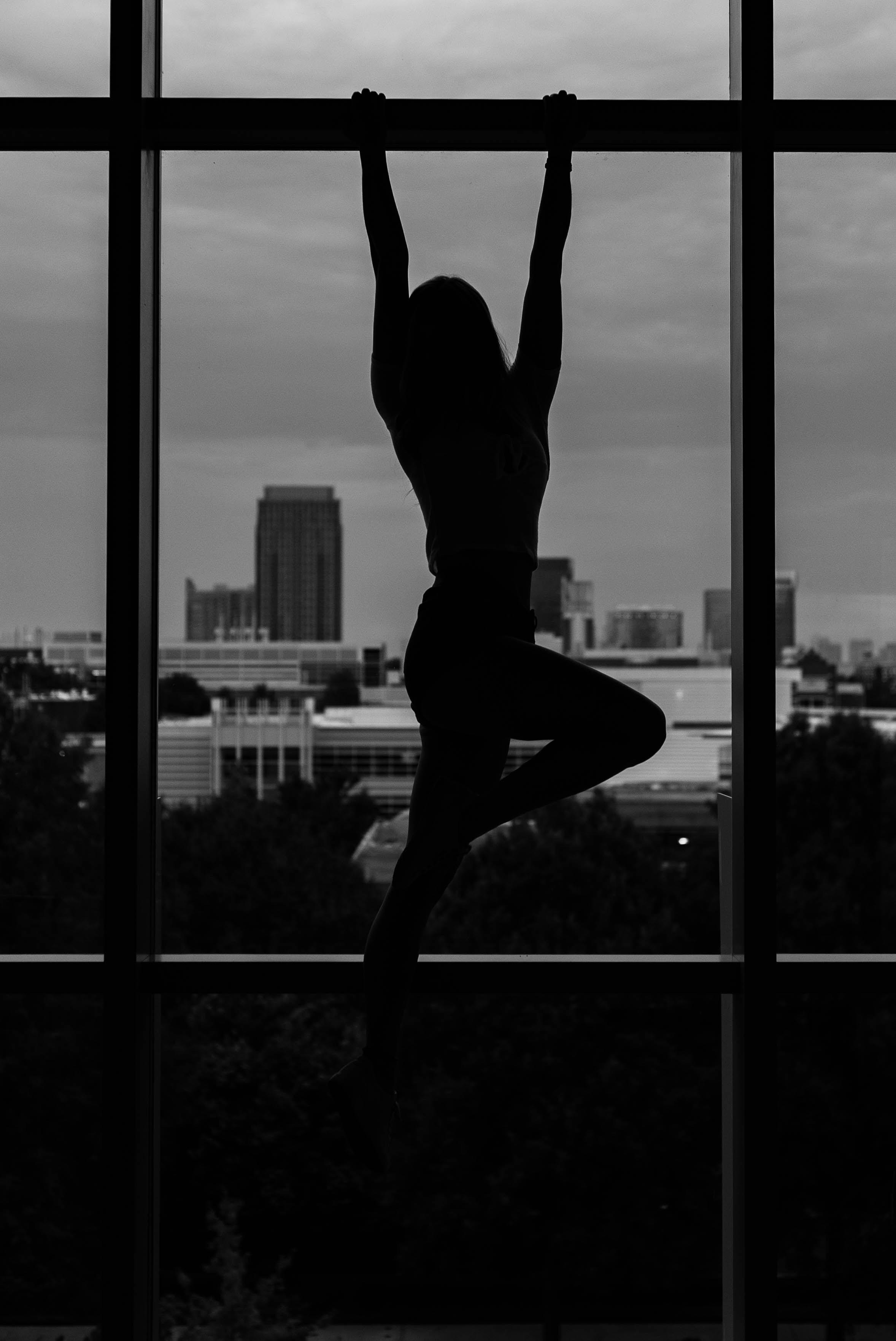 girl hanging on steel beam