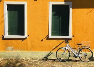 bike parking upright near yellow building