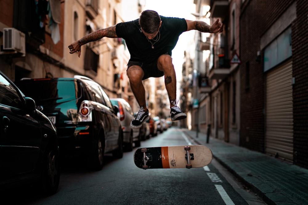 timelapse photography of man riding skateboard