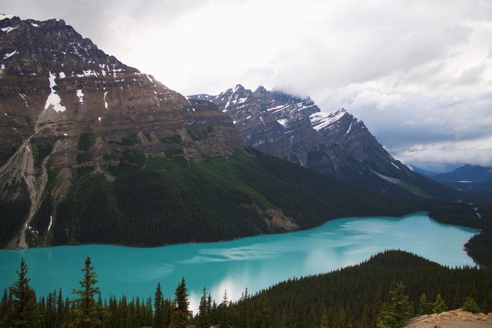 mountain range with blue calm body of water