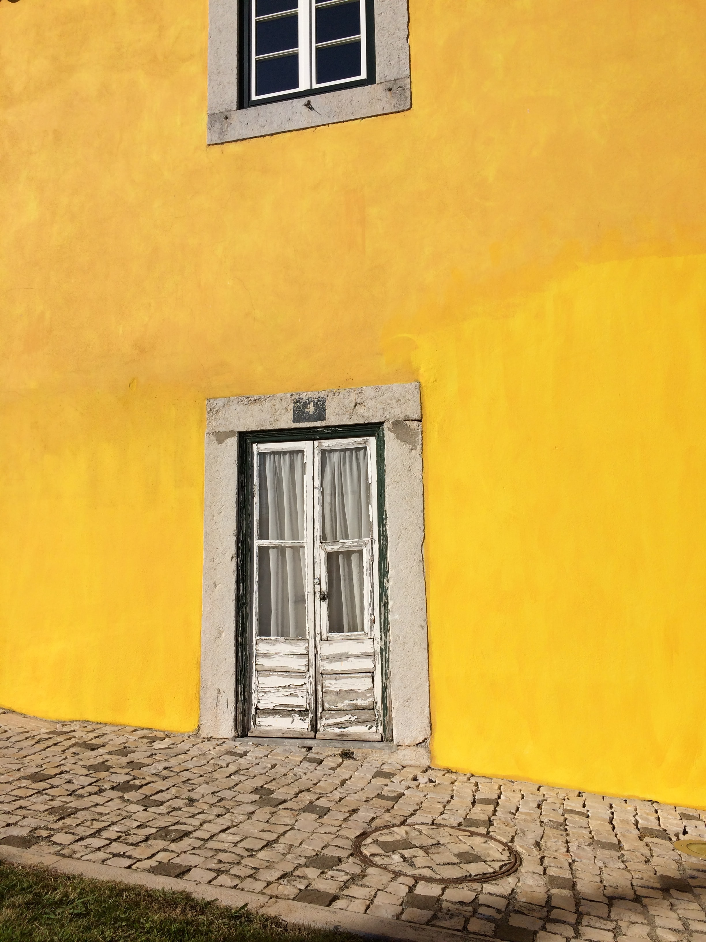 white door on yellow wall