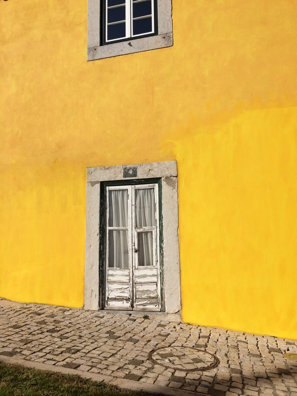 white door on yellow wall