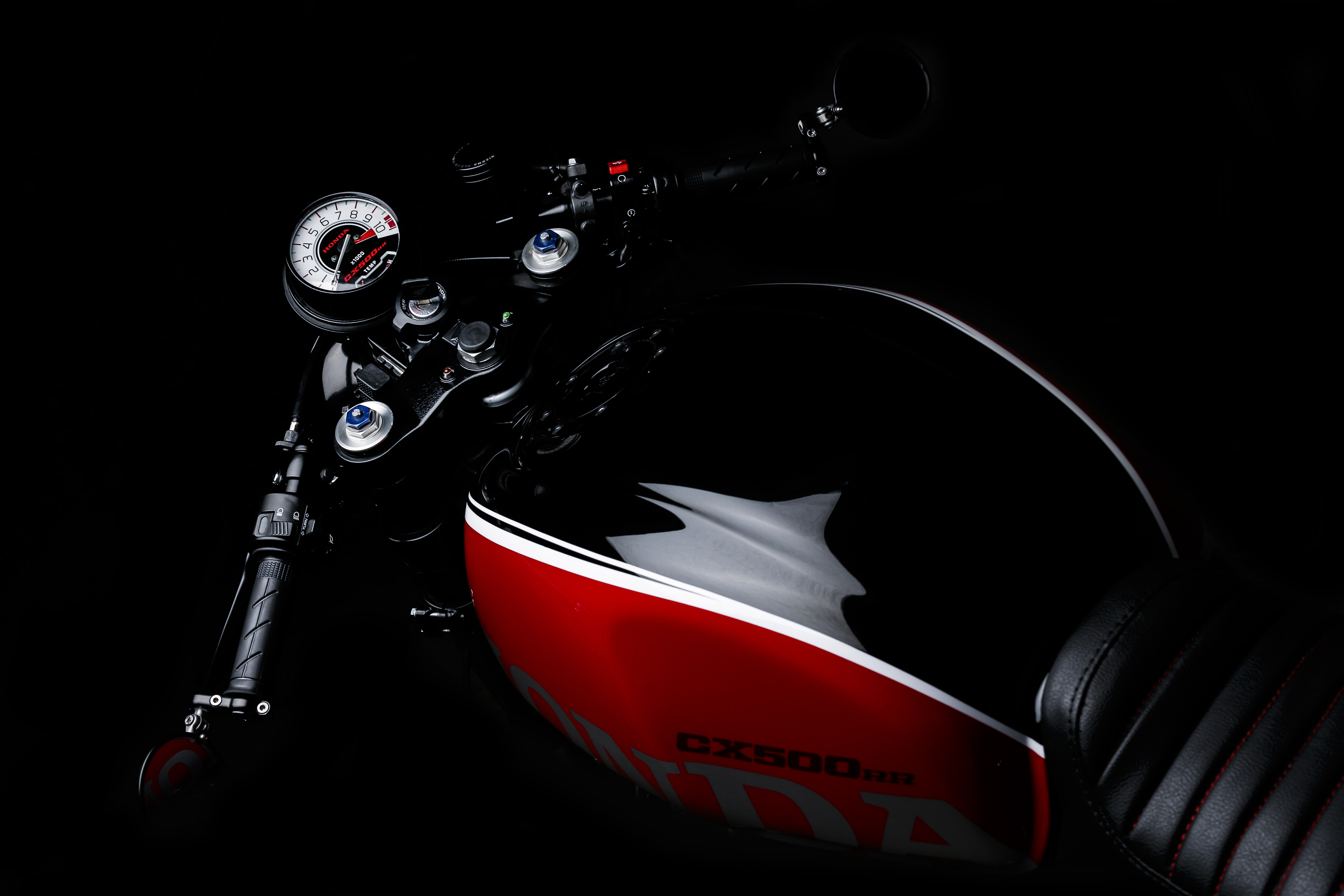 black and red Honda motorcycle