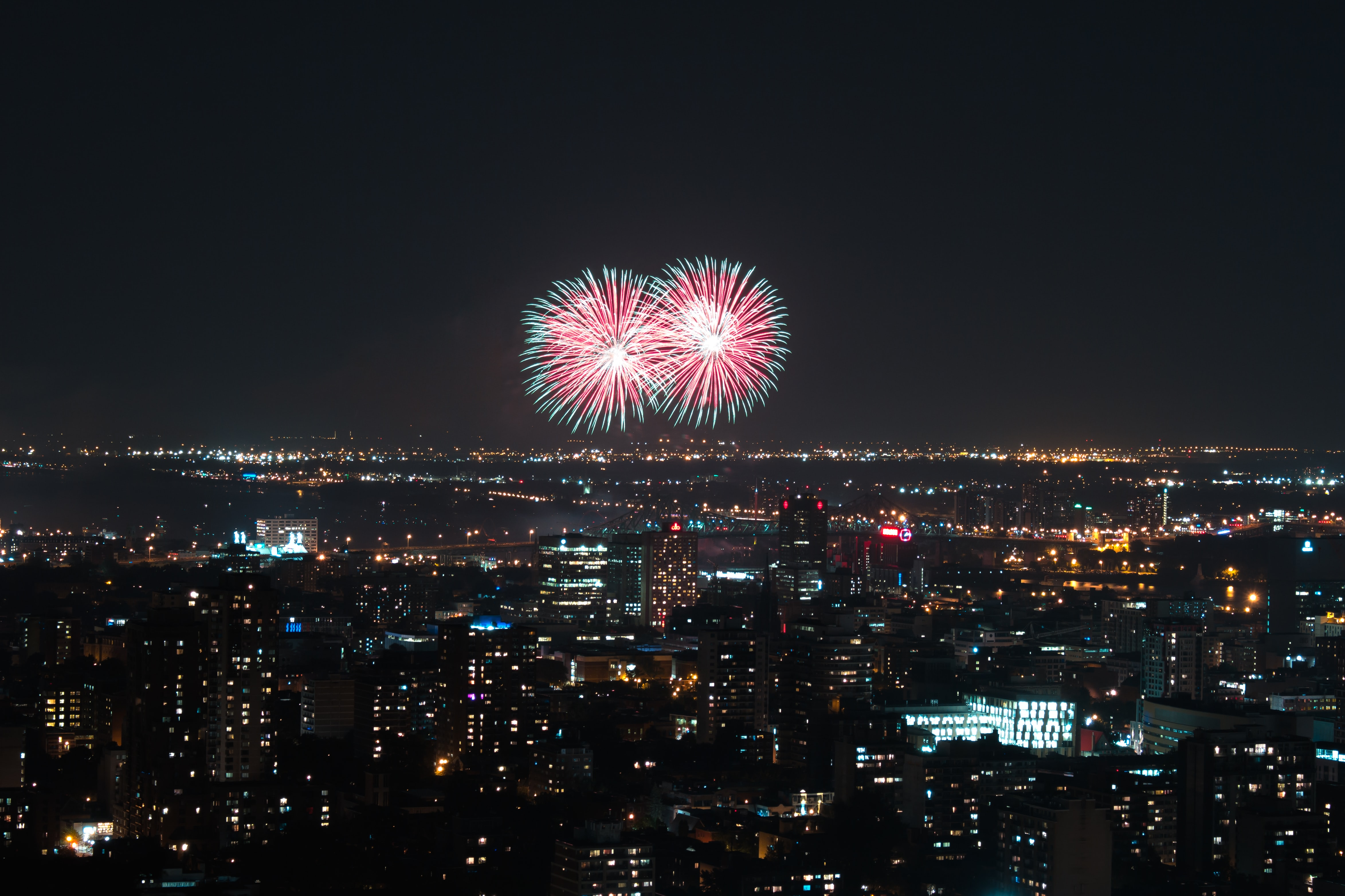 city building under fireworks during nighttime