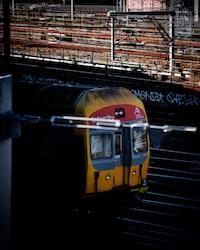 selective focus photography of yellow train on railway