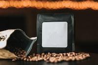 black pack beside coffee bean on desk