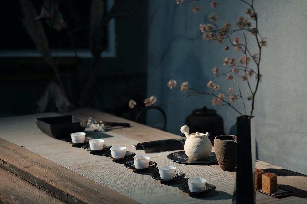white flowers on black ceramic vase