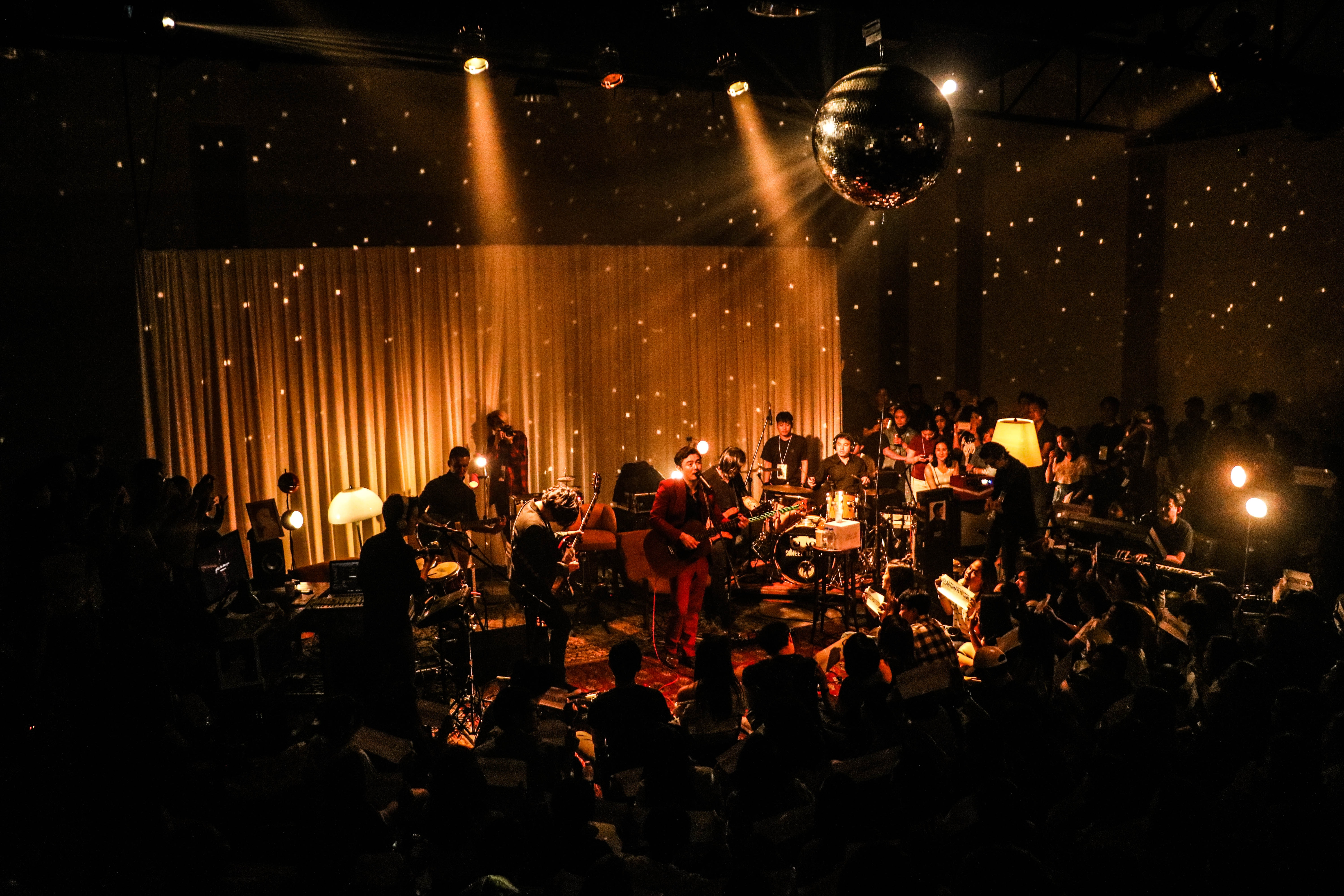 band inside room with disco ball