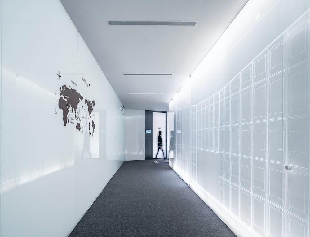 person walking on hallway
