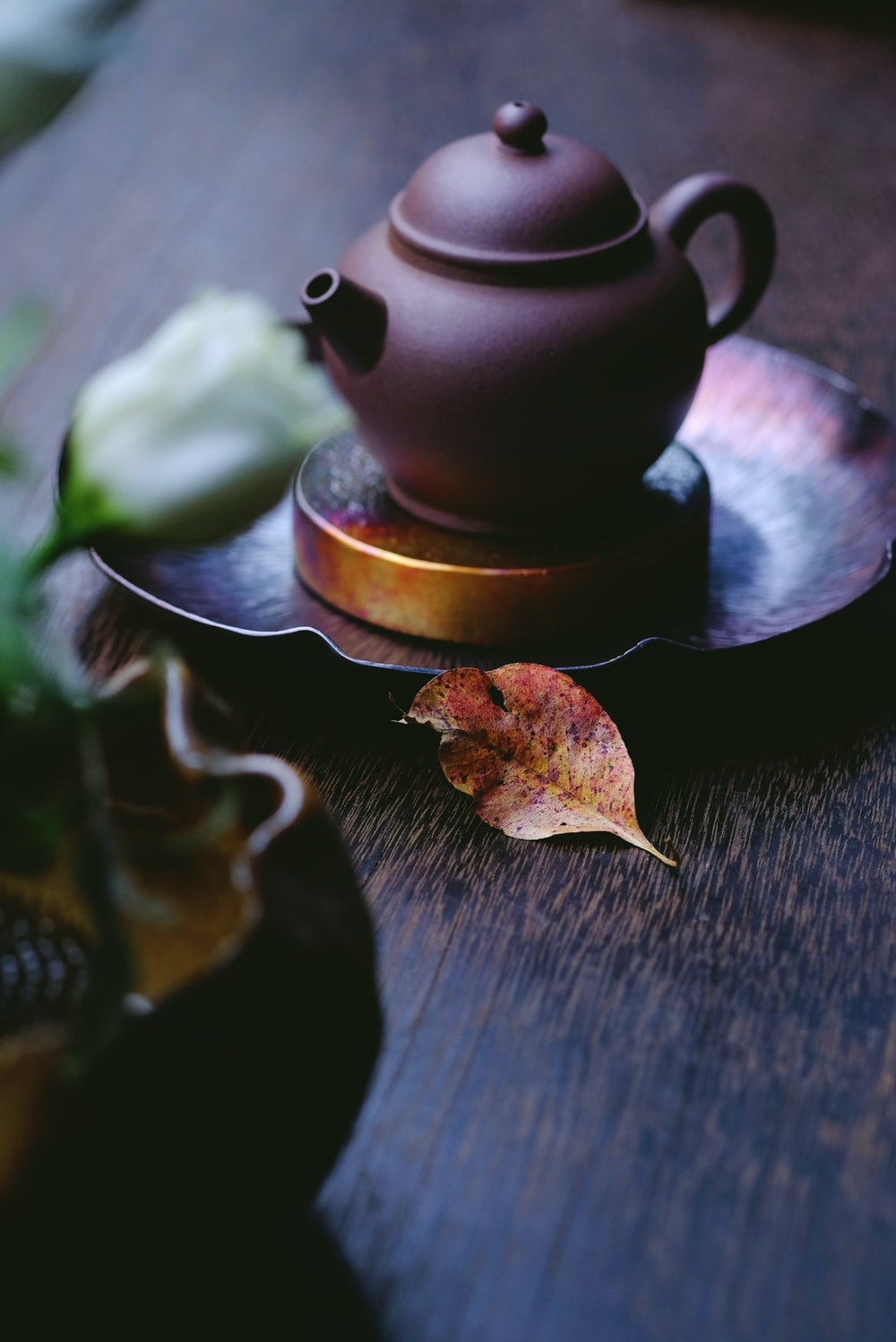brown kettle on saucer