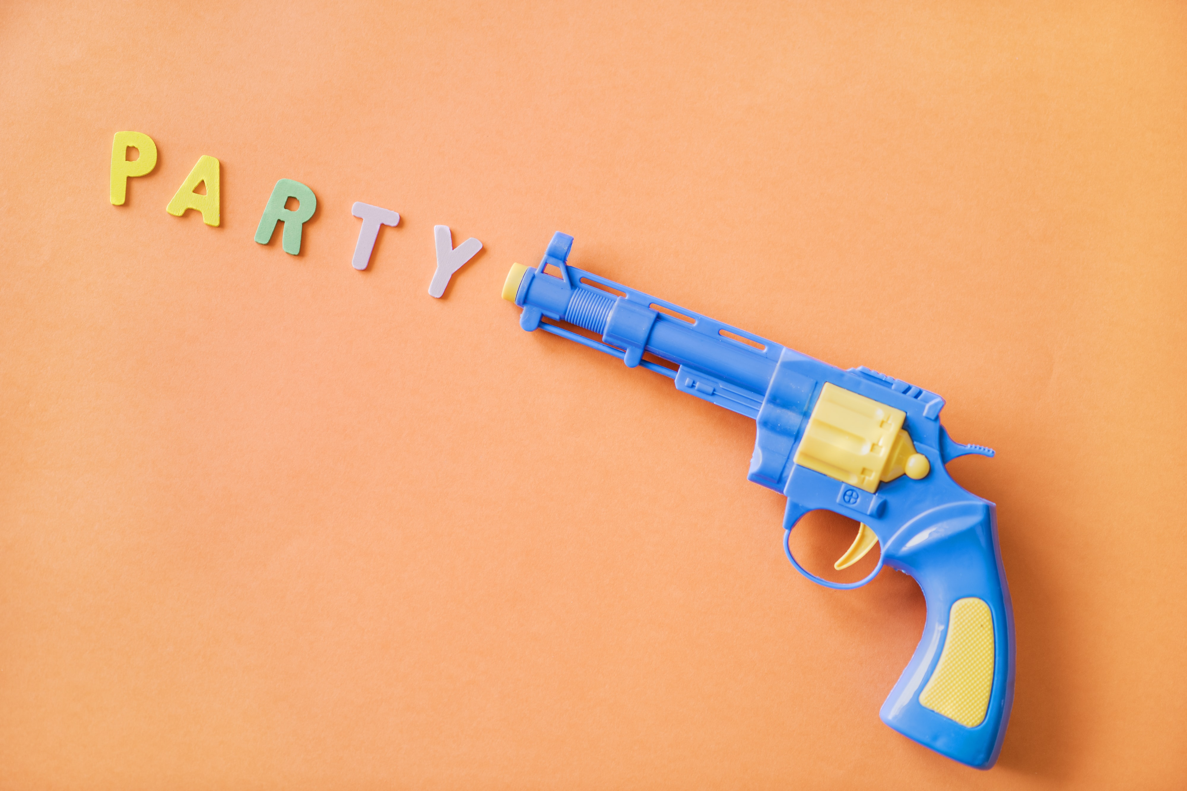blue and yellow plastic revolver toy gun