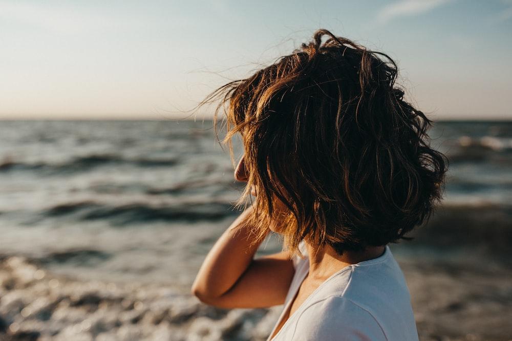 selective focus photography of woman near shoreline