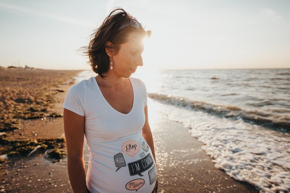 woman standing near shoreline