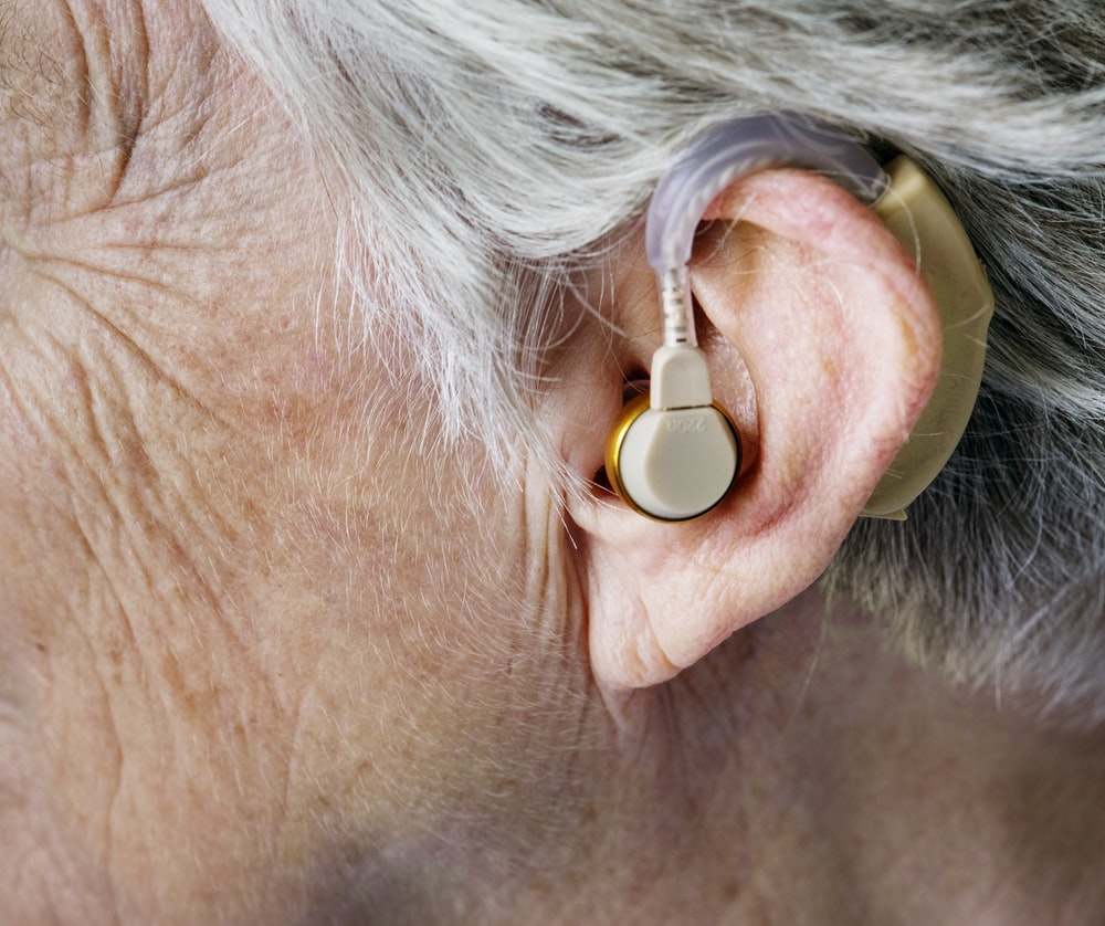 person wearing beige hearing aid